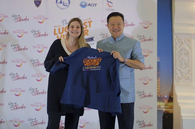 Mr. Yuthasak Supasorn, TAT Governor, presented a 'Thailand's Luckiest Visitor' shirt to Ms. Julie Nathalie A. Ceyssens, the 33 millionth tourist to Thailand