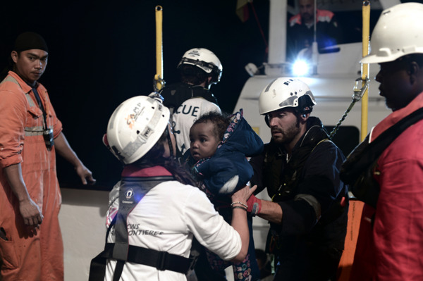 09 June, 2018 - Teams assist a little girl onboard Aquarius, a search and rescue ship run by SOS Mediterranee in partnership with MSF. Credit Kenny Karpov/SOS MEDITERRANEE