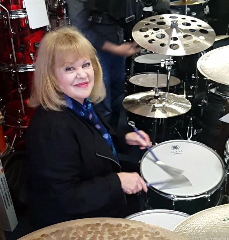 Patricia Amphlett playing the drums.  Photo Charley Drayton.