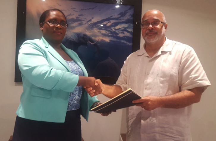 OECS Director General, Dr. Didacus Jules, signs agreement with appointed Chairman of the Audit Committee, Ms. Yvonne James.