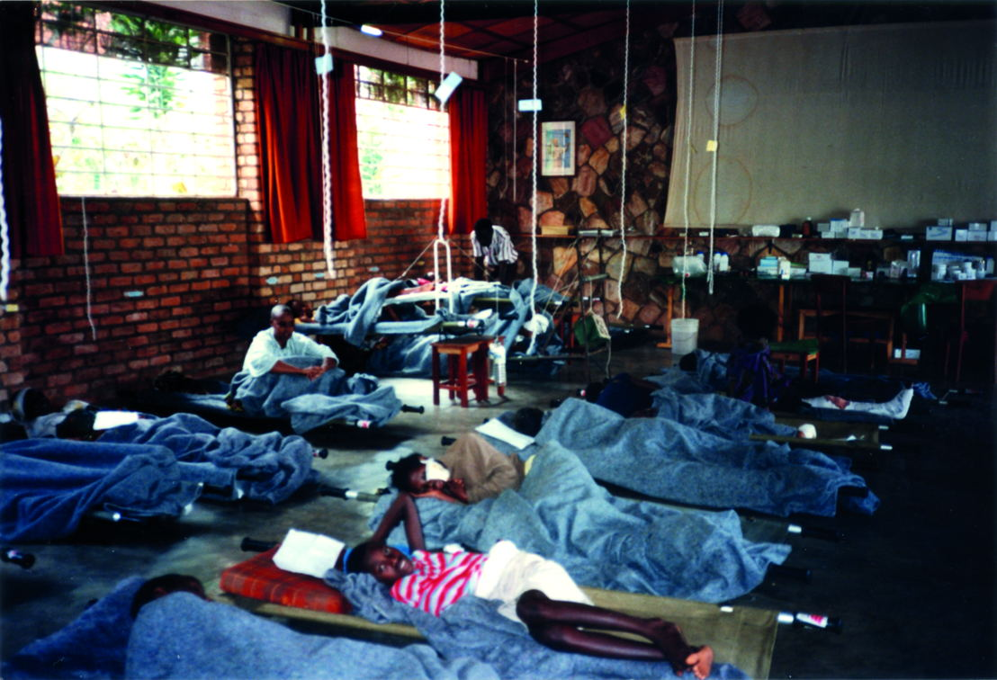 Kigali, genocide Rwandan Tutsis, april 1994. On 13 April 1994, an emergency surgical mission left together with ICRC from Bujumbura in Burundi to Kigali the Rwandan capital city where a few days before had started the genocide of the Rwandan Tutsis. Within hours, an orphanage was converted into a field hospital and the first patients arrived on the very evening of the team's arrival. From 13 April 1994 until Kigali was taken by the Rwandan Patriotic Front (RPF) early July 1994, MSF teams in collaboration with the ICRC ran this hospital that over the weeks became a real refuge for the survivors of the massacres. Photographer: Xavier Lassalle