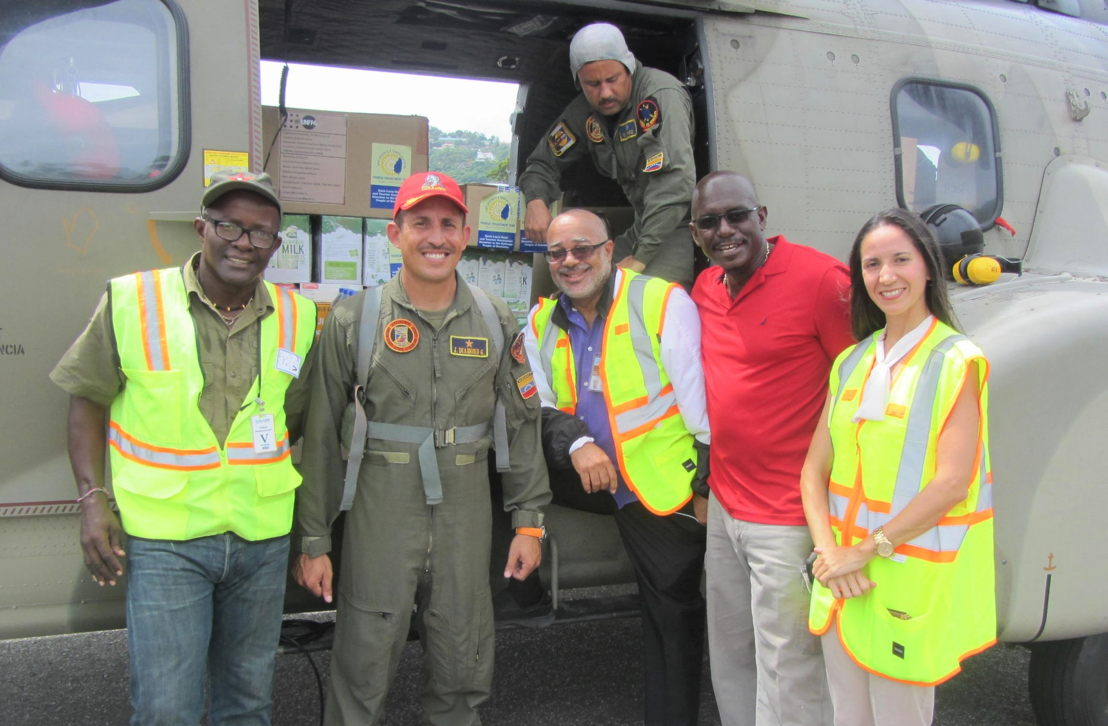 Venezuelan Helicopter drop prepares to leave: (L to R): Former Non-Resident Ambassador to Petro-Caribe and ALBA, Eustace Vitalis, Venezuelan Flight Operations Manager, OECS Director General, H.E Dr. Didacus Jules, Grenada's Ambassador to the OECS H.E Dr. Patrick Antoine and Venezuela's Ambassador H.E Leiff Escalona.