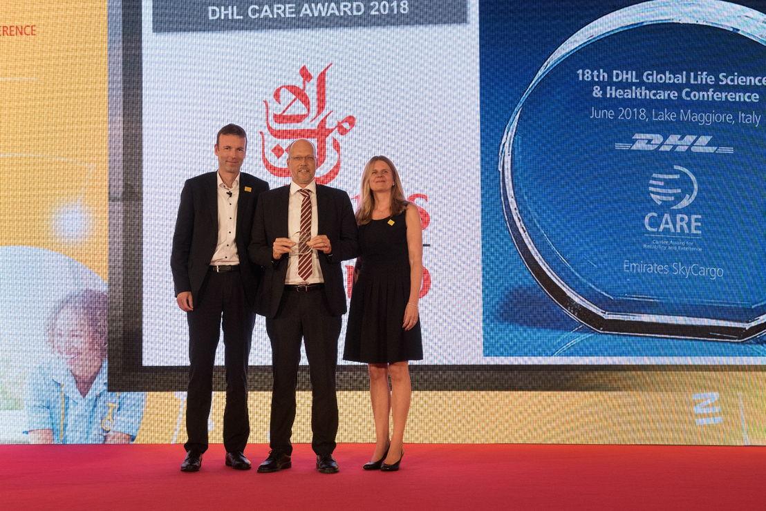 Henrik Ambak- Emirates Senior Vice President, Cargo Operations Worldwide (centre) receiving the award from Thomas George, CEO DHL Global Forwarding Europe (left) and Nina Heinz, Global Head of Network & Quality, DHL Global Forwarding (right)