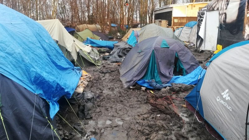 Photographer: Sophie-Jane Madden<br/><br/>Caption: Refugees in the Gramde Synthe refugee camp near Dunkirk, France, contend with deplorably bad conditons in the camp with mud, flooding and a lack of sanitation. Authorities have imposed a ban on humanitarian agencies bring in any building materials or any extra comfort items such as blankets despite the desparate conditions and deteriorating health of the inhabitants.