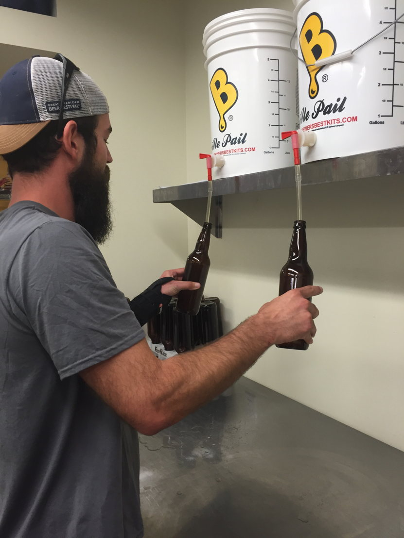 William Brant fills sanitized bottles with Worth the Wait Cantaloupe Gose