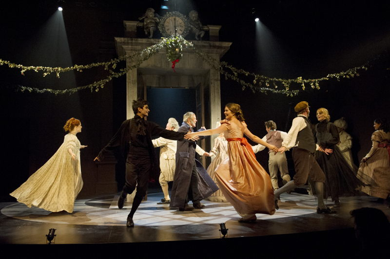 Fezziwig Dance Sequence featuring (L to R): Amanda Lisman (Belle), Daniel Fong (Spirit), Brian Linds (Mr. Fezziwig - facing upstage), Tom McBeath (Ebenezer Scrooge), Celine Stubel (Flora),  Kevin Kruchkywich (Young Ebenezer Scrooge - facing upstage), Adam Lolacher (Dick Wilkins), Jessica Hickman (Spirit), Amisha Parikh-Friese in A Christmas Carol / Photos by David Cooper