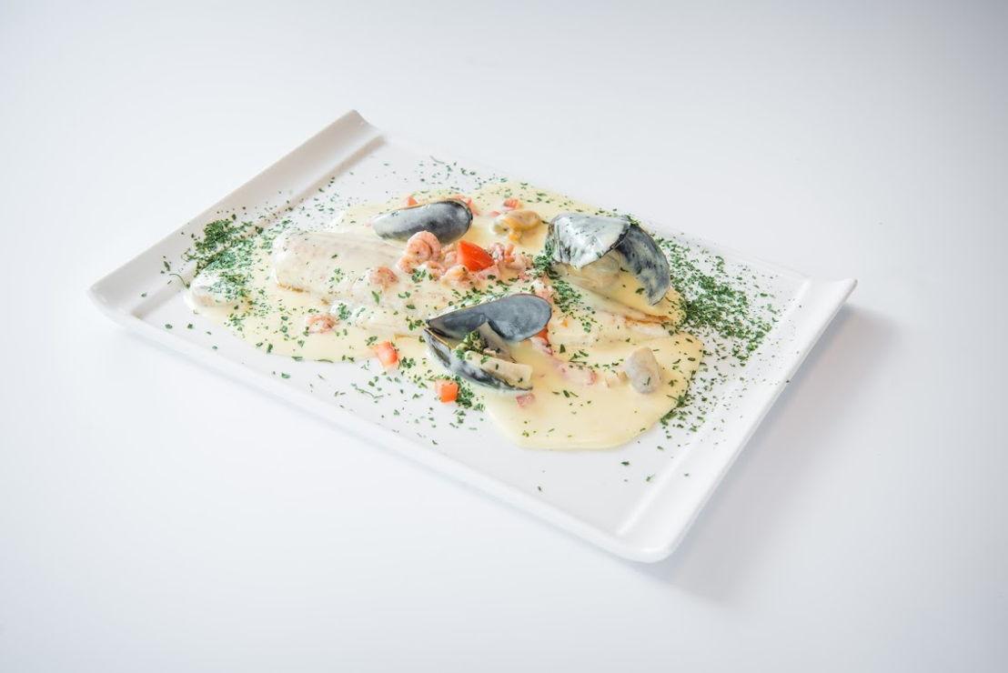 Brasserie Leon Spilliaert - Pladijsfilet Ostendaise met witte wijnsaus, tomaatjes, garnaaltjes, champignons en peterselie.