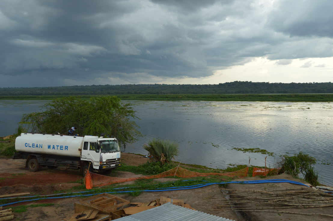 A water truck is seen at MSF's water treatment plant in Palorinya refugee settlement, northern Uganda. MSF produces an average of 2 million litres per day from the Albert Nile River, which is delivered to tanks throughout the settlements by water trucks rented by UNHCR. Bad road conditions make it difficult for trucks to access all areas of the settlements after heavy rains, leaving several areas vulnerable to water shortages. <br/>By 5 May 2017, there were over 901,755 South Sudanese refugees in Uganda, with the number expected to rise to nearly one million by the end of the year. Some 86% of the South Sudanese refugees in Uganda are women and children under 18, and an average 2,000 new refugees arrive each week. Uganda is now the largest hosting country for South Sudanese refugees, and also the country hosting the largest population of refugees in Africa.<br/>population of refugees in Africa. Photographer: Yuna Cho/MSF