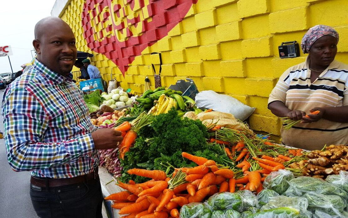Minister Saboto Caesar reviews variety of crops at a market in Dominica earlier this year.