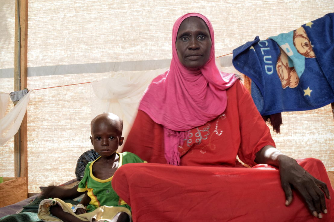 """Zara Abba, 32, from the capital of Chad, N'djamena, has been in the MSF intensive care unit in Bokoro town for four days. She is there with her granddaughter, Katalma Moussa who is two years old. <br/>Zara Abba was visiting Bokoro to pay her respects to a family member who&#039;d died when her granddaughter fell ill. """"She hadn't put much weight on for a while and then she started to get diarrhoea and her health got even worse. She hasn't had any energy to be able to play with other children.""""<br/>""""This is my daughter's first child. She's still in N'djamena but I've been speaking to her every day. She calls to ask about the health of her daughter. I say her daughter is getting better. MSF have gone above and beyond to help your daughter. They've worked really hard.""""<br/>Zara Abba also has a two year old daughter of her own. """"I would travel all the way to France for my children's health."""" She says. """"I have given birth to 15 children. Seven of them have died and eight are still living. Two of them were twins and they died on the same day they were born. The others, I don't know why, it was God's choice."""" Photographer: Charlotte Morris"""