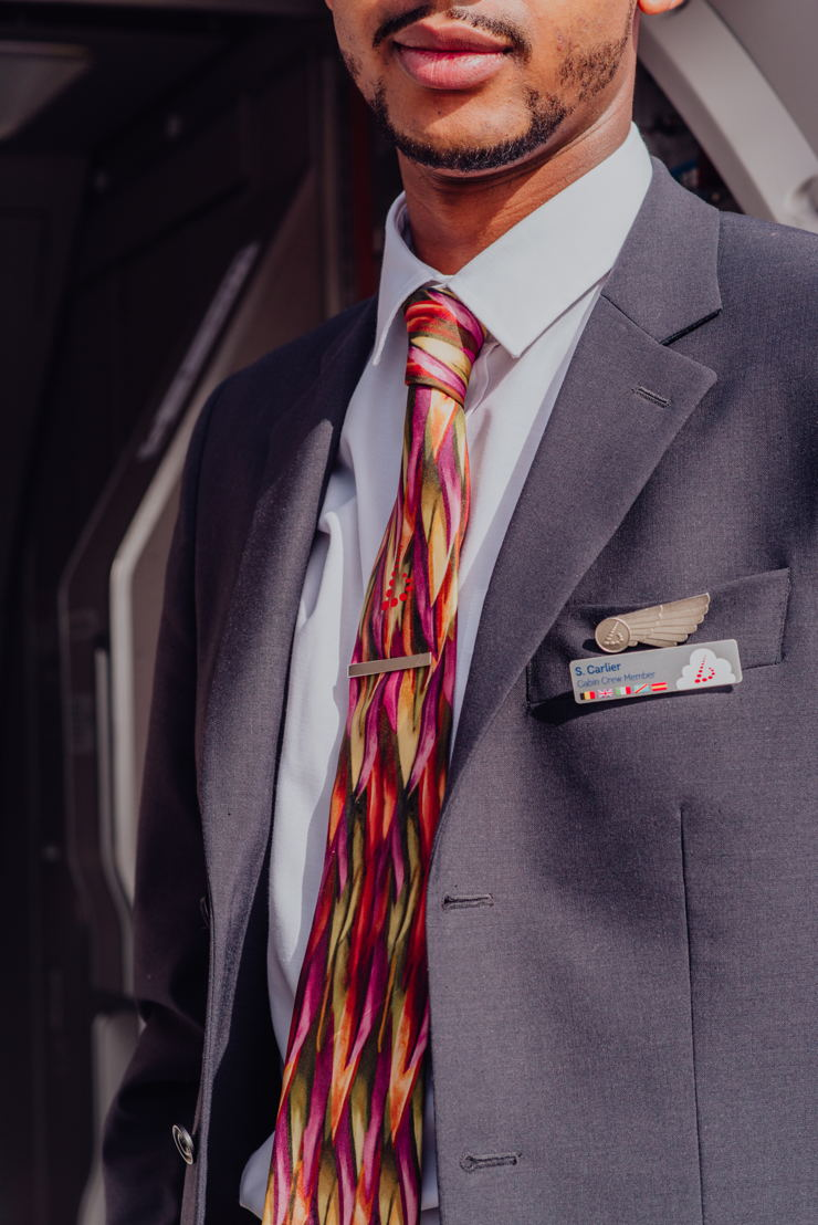 Special cabin crew ties, based on the design of Amare