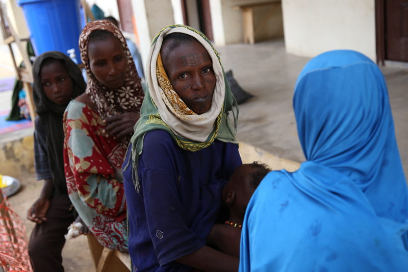 Patients wait at MSF's health facility in the northeastern Nigerian town of Banisheikh, where the organisation runs an inpatient therapeutic centre and a paediatric ward. Photographer: Igor Barbero