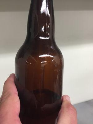Filling the sanitized bottles with cantaloupe gose