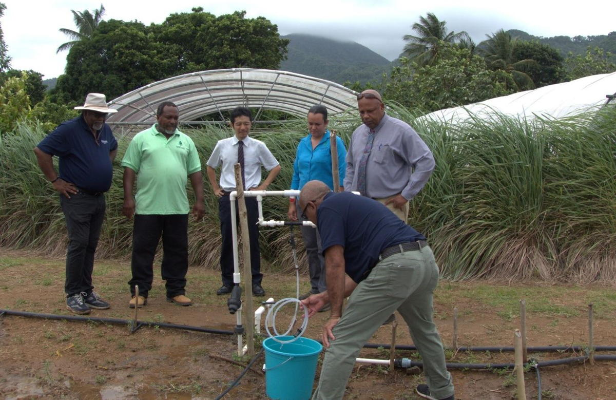Minister of Agriculture in Saint Lucia, Hon. Ezechiel Joseph; Second Secretary Toshihide Kanaya, Embassy of Japan; and CARDI representative witness an Injector Irrigation Demonstration at the CARDI Field Station, Saint Lucia.