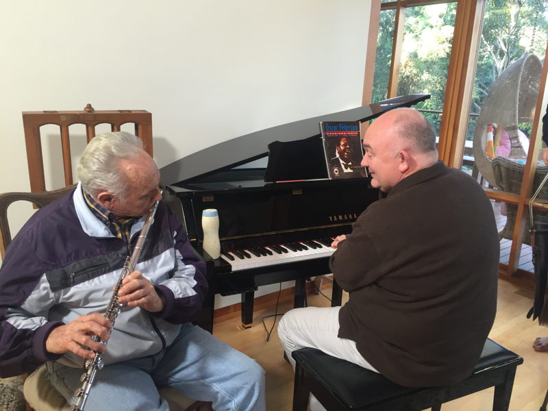 Don playing flute with James