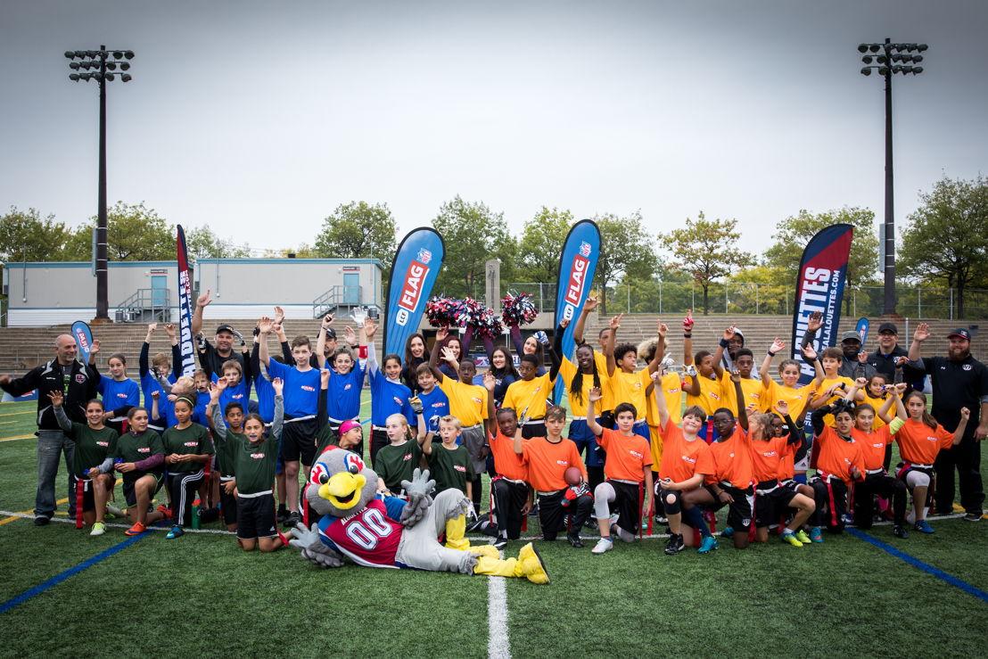 Les participants au tournoi régional de flag-football LCF/NFL de Montréal, présenté samedi au Complexe sportif Claude-Robilllard. Crédit : Dominick Gravel / LCF.