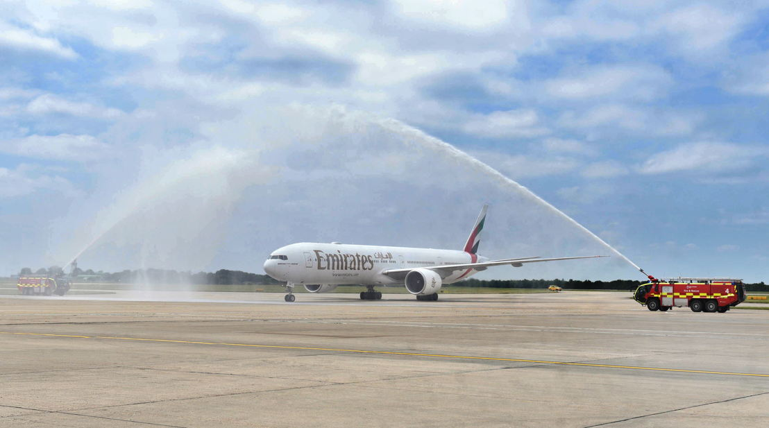 A water cannon salute welcomes Emirates' inaugural flight to London Stansted.