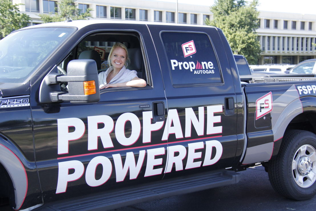 Becky Borkgren, GROWMARK Propane marketing and technical services manager, poses in her propane autogas truck.