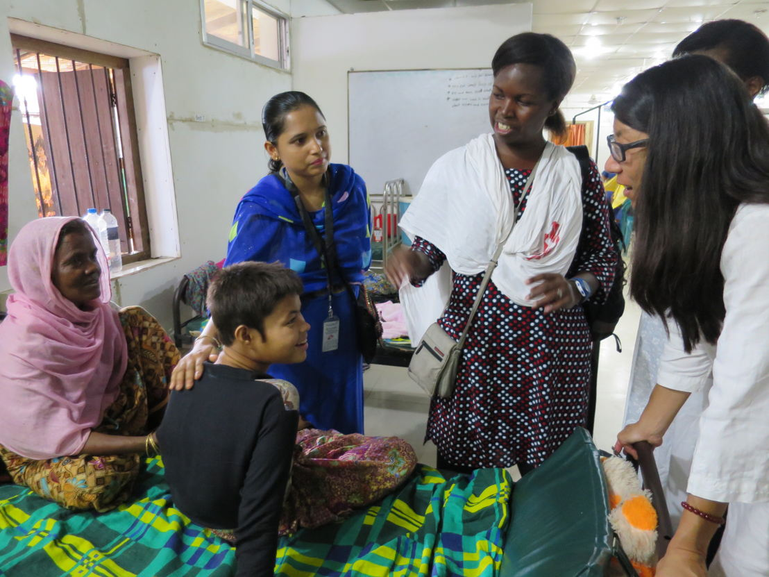 (left to right) An MSF carer sits with a young girl, who's believed to be about 15 years, and is currently being looked after at MSF's maternity ward at Kutupalong Clinic, Cox's Bazar. The teenager was found severely injured, and lost, after crossing the border from Myanmar. Here she meets with MSF's Nurse Supervisor Lucky Shamsun Naher Begun, Nurse Activities Manager Jacqueline Murekezi and MSF's President Joanne Liu, while she is taken on a tour of the facility. Photographer: Amelia Freelander