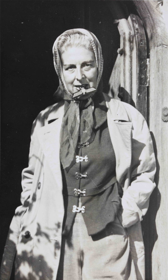 Self portrait (with Nazi badge between her teeth) by Claude Cahun, 1927. Jersey Heritage Collections © Jersey Heritage
